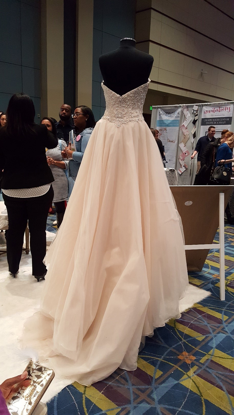 A blush colored wedding dress ensemble